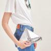 SIMONE RAINER - Silver leather triangular clutch